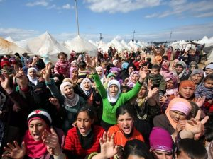 Syrian refugees protest against President Bashar al-Assad